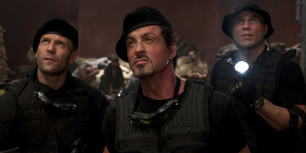 Lee Christmas (Jason Statham), Barney Ross (Sylvester Stallone) og Toll Road (Randy Couturet) i The Expendables